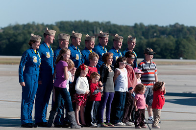 The Blue Angels visit with a group of children from the Make-A-Wish Foundation