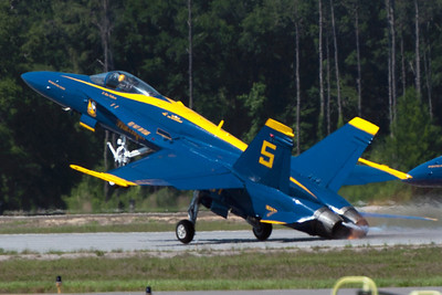 The sparks really fly as Blue Angel number 5 takes off and hits his exhaust cones against the runway.