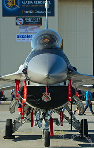 "The General Dynamics (now Lockheed Martin) F-16 Fighting Falcon is a single-engine multirole fighter aircraft originally developed by General Dynamics for the United States Air Force (USAF). Designed as an air superiority day fighter, it evolved into a successful all-weather multirole aircraft. Over 4,500 aircraft have been built since production was approved in 1976. Although no longer being purchased by the U.S. Air Force, improved versions are still being built for export customers. In 1993, General Dynamics sold its aircraft manufacturing business to the Lockheed Corporation, which in turn became part of Lockheed Martin after a 1995 merger with Martin Marietta. The Fighting Falcon has key features including a frameless bubble canopy for better visibility, side-mounted control stick to ease control while maneuvering, a seat reclined 30 degrees to reduce the effect of g-forces on the pilot, and the first use of a relaxed static stability/fly-by-wire flight control system helps to make it a nimble aircraft. The F-16 has an internal M61 Vulcan cannon and 11 locations for mounting weapons and other mission equipment. The F-16's official name is ""Fighting Falcon"", but ""Viper"" is commonly used by its pilots, due to a perceived resemblance to a viper snake as well as the Battlestar Galactica Colonial Viper starfighter."