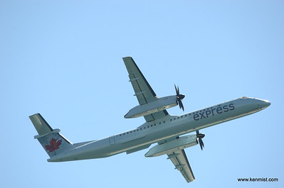 Air Canada Express Bombardier Q400 climbing out after takeoff from Billy Bishop airport (CYTZ) in Toronto.