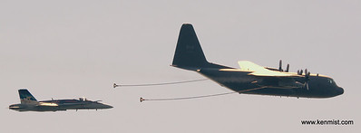 CF-18 Demonstration Team Hornet and CC-130 Hercules simulate refueling process prior to the Hornet heading from the Canadian International Air Show in Toronto to Cleveland Ohio to take part in their display.