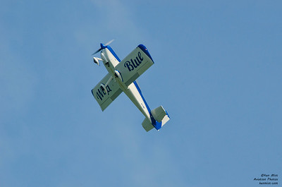 "Jerry ""JIve"" Kerby climbs Wild Blue into a brilliant blue sky at the 2015 National Warplane Museum Geneseo Airshow."