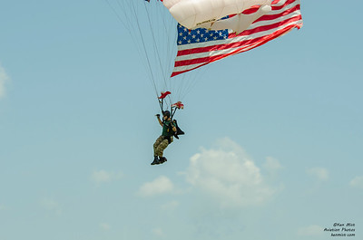 Sunnydale Hyde of the All Veterans Parachute Group arrives with the US flag at the 2015 National Warplane Museum Geneseo Airshow.