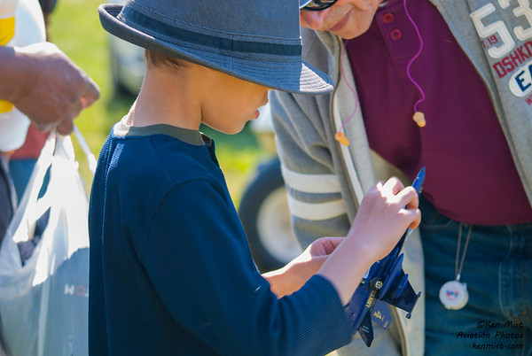 A young air show enthusiast shows his Blue Angels model to announcer Bill Lowe at the 2015 Rochester International Air Show.