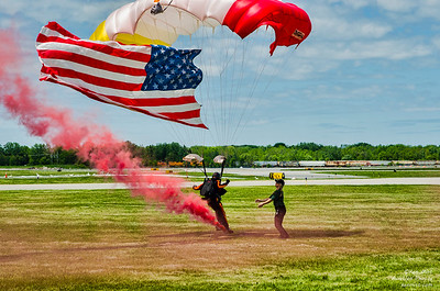 member of the All Veterans Group parachute team executes a perfect landing during practice for the 2015 Rochester Air Show.