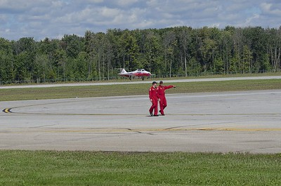Snowbirds 10 and 11 walk while Snowbird 8 arrives