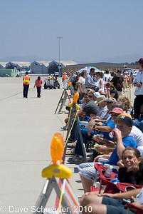 A visit to the Camarillo Air Show. Everyone is having a good time, except the young lady in the foreground.