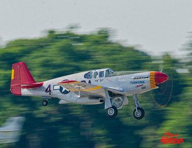 "Tuskegee airman Lt. Col. George Hardy rides with Doug Rozendall in the ""Tuskegee Airmen"" P-51C at Sun 'n Fun.  This was George's first ride in a Mustang since 1946."