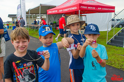 Young visitors to Sun 'n Fun showing their new dog tags outlining the 6 principles of Rise Above