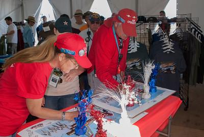 Veterans signing commemorative poster