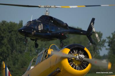 Harvard foreground, Bell 222B in background at Tillsonburg Regional Airport