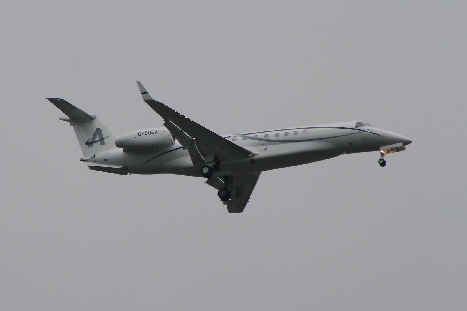 G-SUGA An Embraer EMB-135BJ Legacy 650 of Amsair on approach to Glasgow Airport. Owned by Lord Sugar, it is the first Legacy 650 on the UK registry and operated by Air Charter Scotland. It is now owned and operated by Embraer Executive Aircraft
