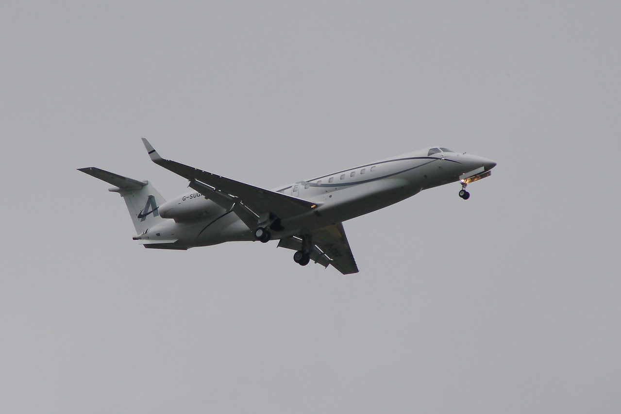 An Embraer EMB-135BJ Legacy 650 (G-SUGA) of Amsair on approach to Glasgow Airport. Owned by Lord Sugar, it is the first Legacy 650 on the UK registry and operated by Air Charter Scotland. It is now owned and operated by Embraer Executive Aircraft