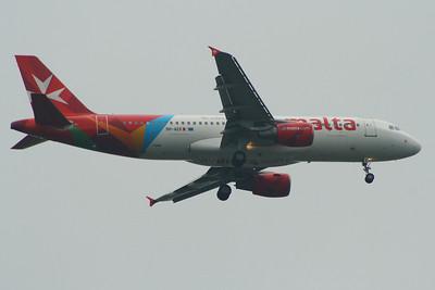 9h-AEK An Air Malta Airbus A320-214 on approach to Glasgow Airport