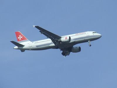 9H-AEI An Air Malta Airbus A320-214 on approach to Glasgow Airport