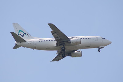 F-HCOA A Boeing 737-5L9 of Air Mediterranee on approach to Glasgow Airport