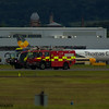 Glasgow Airport Fire Tender 2 and Fire Tender 5, a Rosenbauer CA5 Panther, and Scania 124C-420/Carmichael Viper of Glasgow Airport Fire Service on 26/06/2016 having a practice run up the runway in between fights