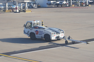 A Europe Handling Roissy TLD pushback tractor at Paris Charles de Gaulle after taking Easyjet Airbus A319-111 (G-EZIM) out to the taxiway