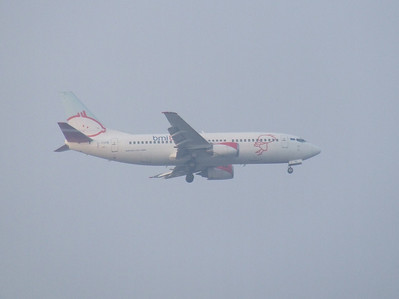 G-TOYB A Bmibaby Boeing 737-3Q8 on approach to Glasgow Airport. It was withdrawn in September 2009