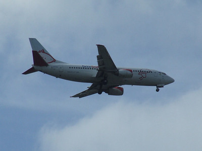 G-BYZJ A Bmibaby Boeing 737-3Q8 on approach to Glasgow Airport. The aircraft was withdrawn in April 2009