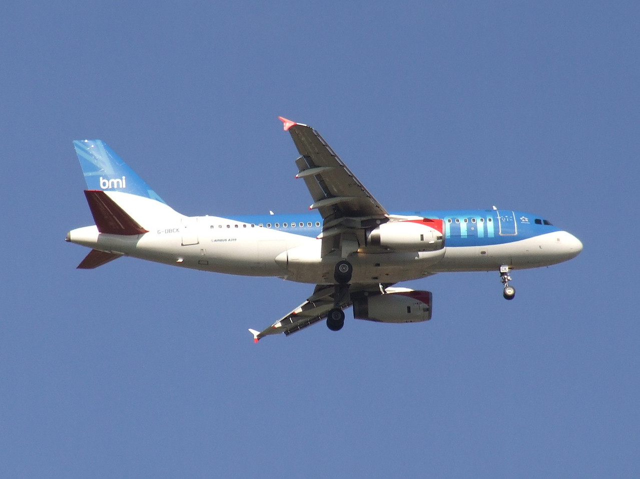 A BMI British Midland Airbus A319-131 (G-DBCK) on approach to Glasgow Airport. Now in use with British Airways after the IAG takeover.