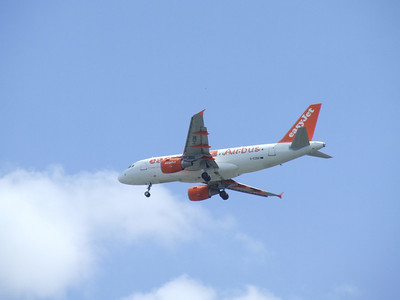 An Airbus A319-111 (G-EZBR) on approach to Glasgow Airport. This is EasyJet's 100th Airbus as denoted by the special markings