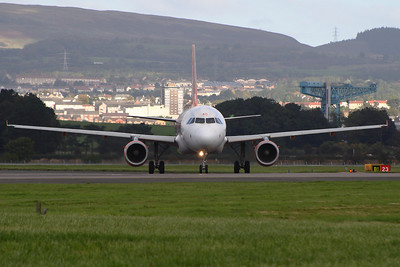G-EZAC.  An Airbus A319-111 taxiing after landing at Glasgow Airport