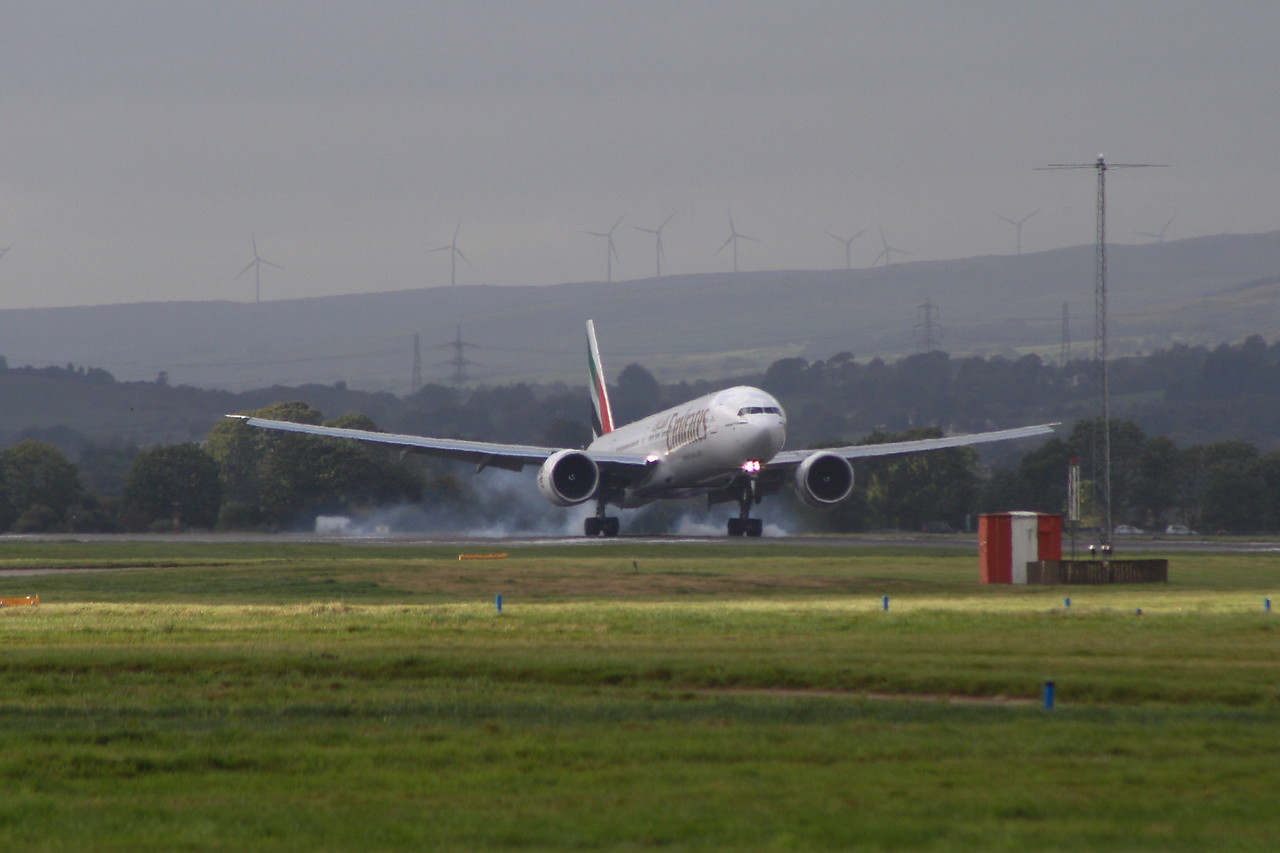 A6-ENE An Emirates Boeing 777-31H/ER  touching down at Glasgow Airport