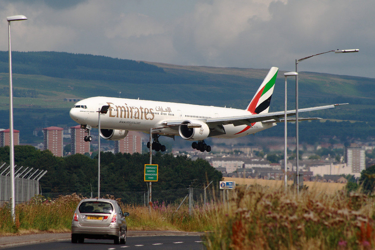 A6-EGP An Emirates Boeing 777-31H/ER on approach to Glasgow Airport. The car in the foreground gives an idea of just how big the B777 is.