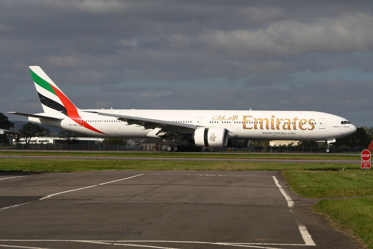 A6-ENE An Emirates Boeing 777-31H/ER landing at Glasgow Airport, along with the reverse thrust in action