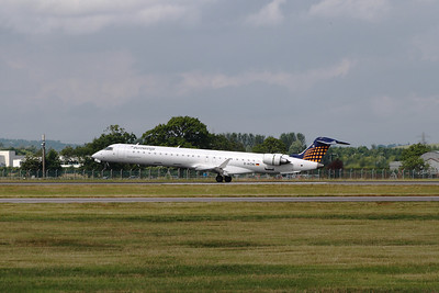 A Eurowings Canadair CL-600-2D24 Regional Jet CRJ-900 (D-ACNI) flaring as it touchs down at Glasgow Airport