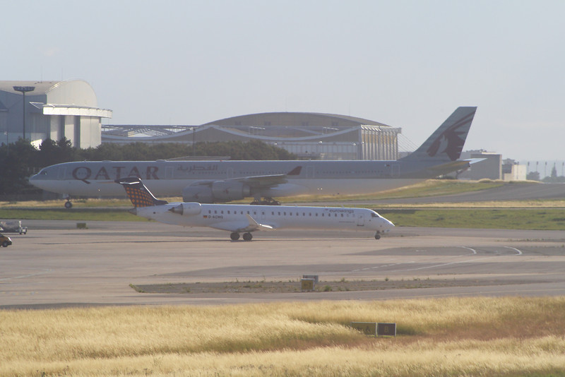 D-ACNQ, A7-AGB A Eurowings Canadair CL-600-2D24 Regional Jet CRJ-900 and a Qatar Airways Airbus A340-642 at Paris Charles De Gaulle Airport
