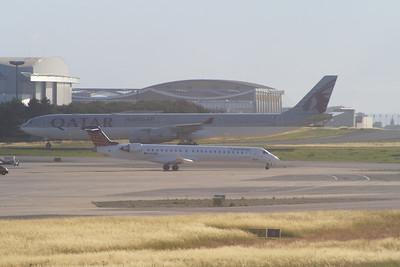 Qatar Airways Airbus A340-642 (A7-AGB) and a Eurowings Canadair CL-600-2D24 Regional Jet CRJ-900 (D-ACNQ) at Paris Charles De Gaulle Airport
