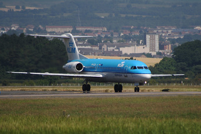 A KLM Cityhopper Fokker 70 (F-28-0070) (PH-KZB) taxiing after landing at Glasgow Airport