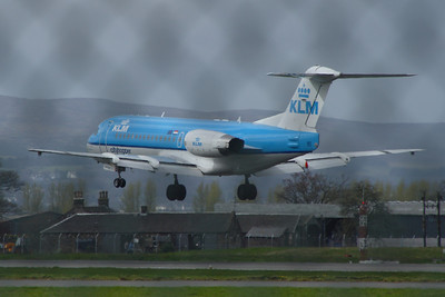 A KLM Cityhopper Fokker 70 (F-28-0070) (PH-KZW) about to land at Glasgow Airport