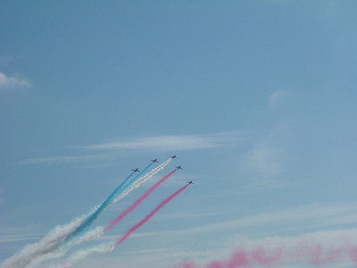 The Red Arrows passing over the airfield in formation