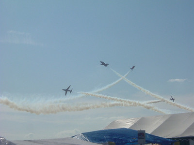 The Red Arrows during a close breaking manouver at low level