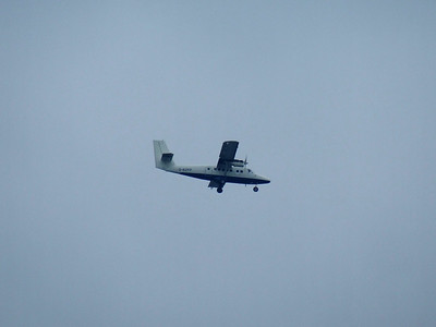 De Havilland Canada DHC-6-300 Twin Otter (G-BZFP) on approach to Glasgow Airport. It is unbranded after having lost it's British Airways livery after the change in franchise