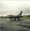 84-1304<br> General Dynamics F-16C Fighting Falcon<br> 496th Tactical Fighter Squadron<br> US Air Force<br> Prestwick Airport<br> 30/05/1987<br> <i>Based at Hahn AFB, Germany, part of 50th Tactical Fighter Wing. The aircraft was written off in 1999 after it crashed on a training flight at the Barry M Goldwater weapons range in Arizona.  The Westland Sea King HAS5  in the background belongs  to 819 Naval Air Squadron based at HMS Gannett </i>