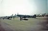 PS853<br> Supermarine Spitfire PR.XIX<br> VP981<br> de Havilland Devon C2<br> Battle of Britain Memorial Flight<br> Royal Air Force<br> Prestwick Airport<br> 06/06/1992<br> <i>Spitfire in the colours of 16 (PR) Squadron, 2nd Tactical Air Force</i>