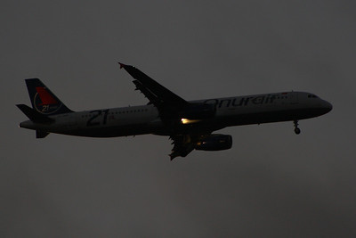 Airbus A321-231 (TC-OBZ) of Onur Air on approach to Glasgow Airport in the gathering gloom