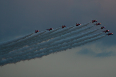 The Red Arrows passing over and saluting Glasgow Airport after taking part in the Glasgow 2014 Commonwealth Games opening ceremony
