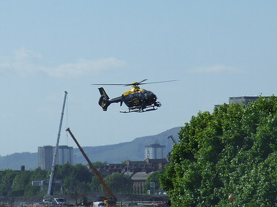 A Eurocopter EC-135T-2 of Strathclyde Police (G-SPAO) on approach to Glasgow City Heliport. It is operated and maintained by Bond Helicopters