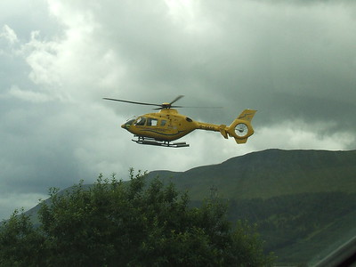 Eurocopter EC-135T-2+ of Scottish Ambulance Service (G-SASB) landing next to the A9 in Perthshire at the scene of a car crash