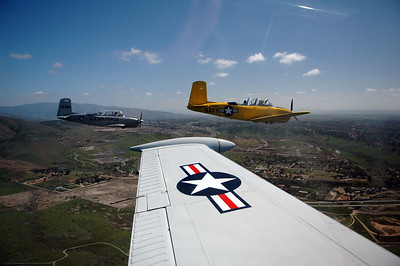 Formation flying with T-34a Mentor aircraft in San Diego. Departing Gillespie Field (KSEE), landing at Brown Field (KSDM) for fuel, flying over San Diego Bay, around Point Loma, up the coast past Ocean Beach, Mission Beach, Pacific Beach and La Jolla. Then turning east back to Gillespie.