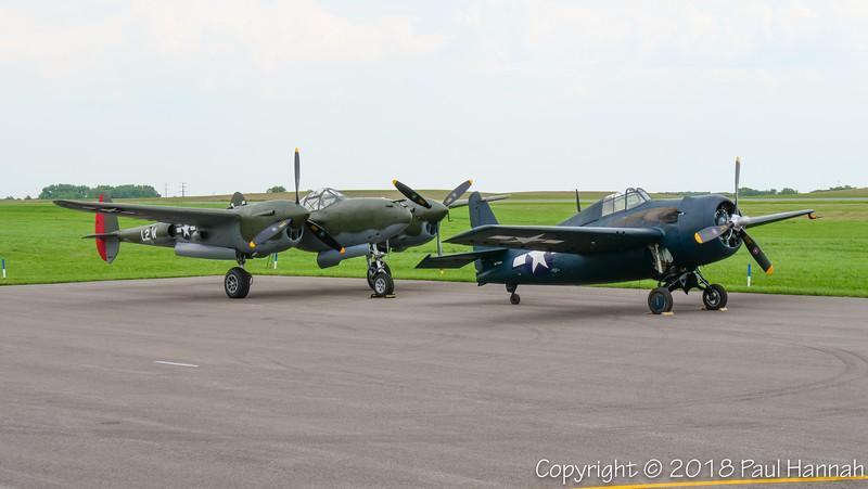 """Fagen Fighters 1945 Lockheed P-38L Lightning """"Scat III"""" (SN 422-8235)  N79123 &  Fagen Fighters 1945 GM FM-2 Wildcat (SN 86774) N774FM"""