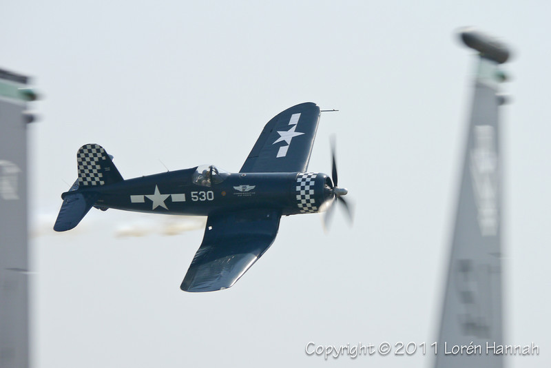 1943 Goodyear FG-1D Corsair, N9964Z<br /> Between F-15 tails