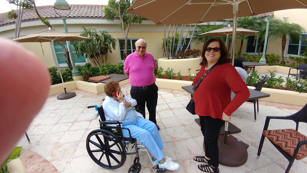 Marian Goldner, Paul Goldner, Sandy Soifer outside on the patio at the care center