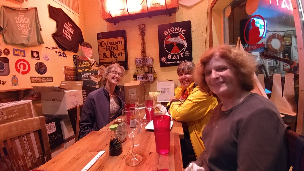 Beth Poulin, Karen Bartel, and Loren Rice at Papa's Raw Bar in Lighthouse Point.