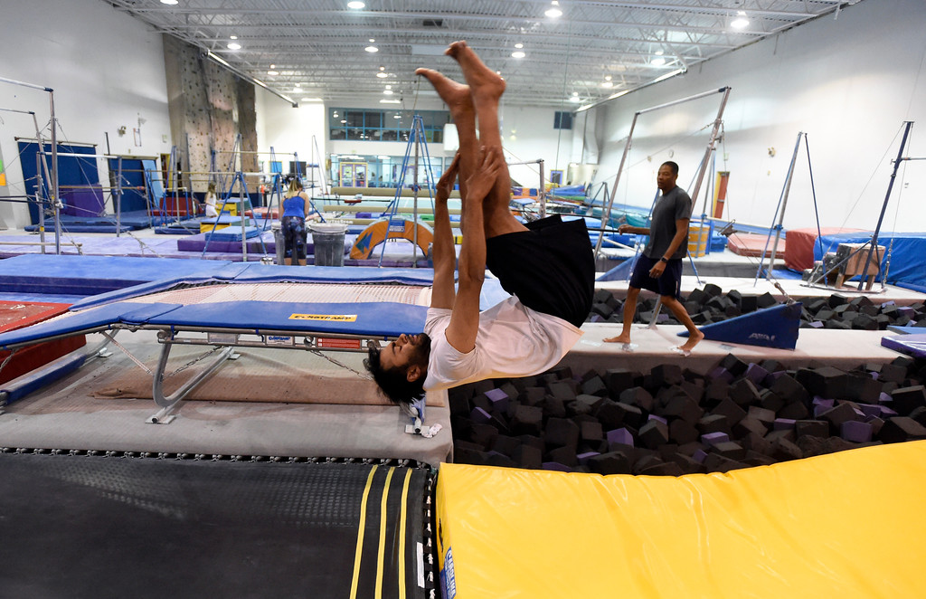 . Adit Jatkar does a flip into the foam pit as he works out at an Airborne Gymnastics workout class on Thursday at Airborne Gymnastics in Longmont. For more photos of the class go to www.dailycamera.com Jeremy Papasso/ Staff Photographer/ March 23, 2017